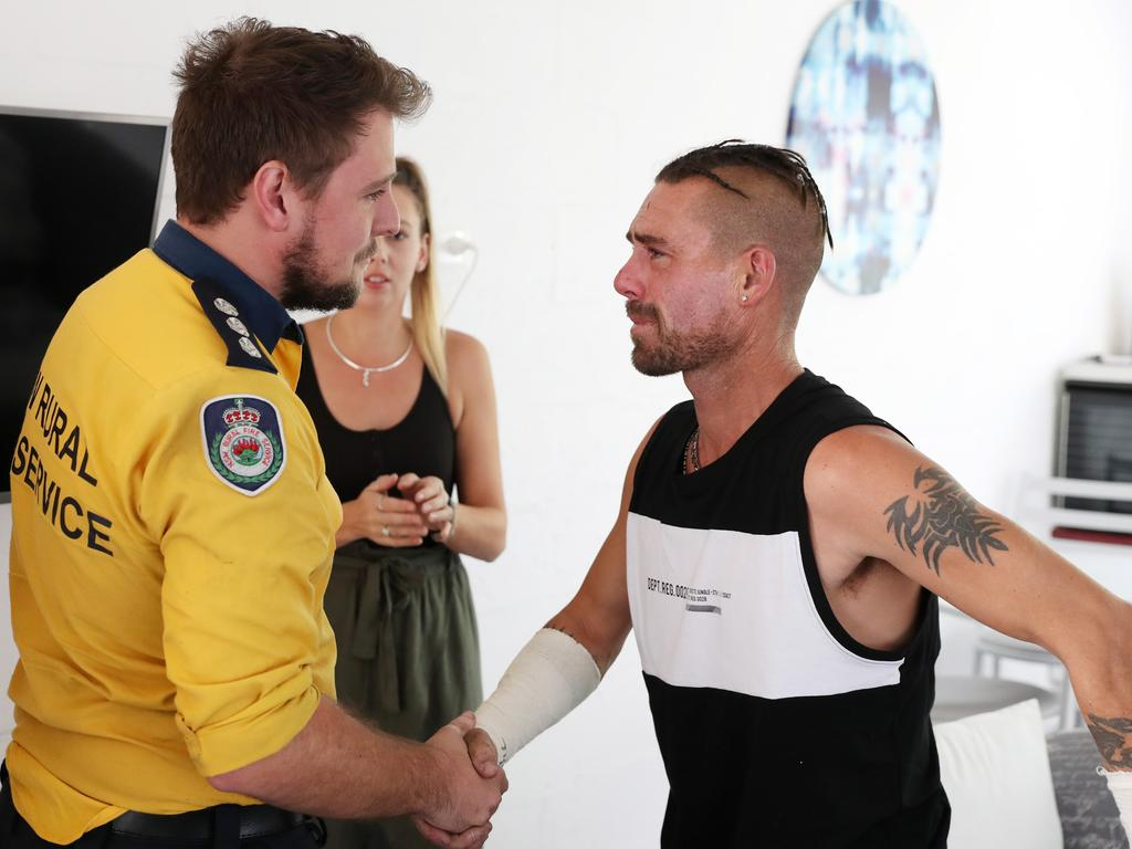 Troy Pauling shakes the hand of RFS firefighter Nathan Barnden. Picture: Jonathan Ng