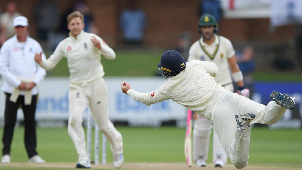 Ollie Pope dives to catch South Africa batsman Rassie van der Dussen off the bowling of Joe Root.