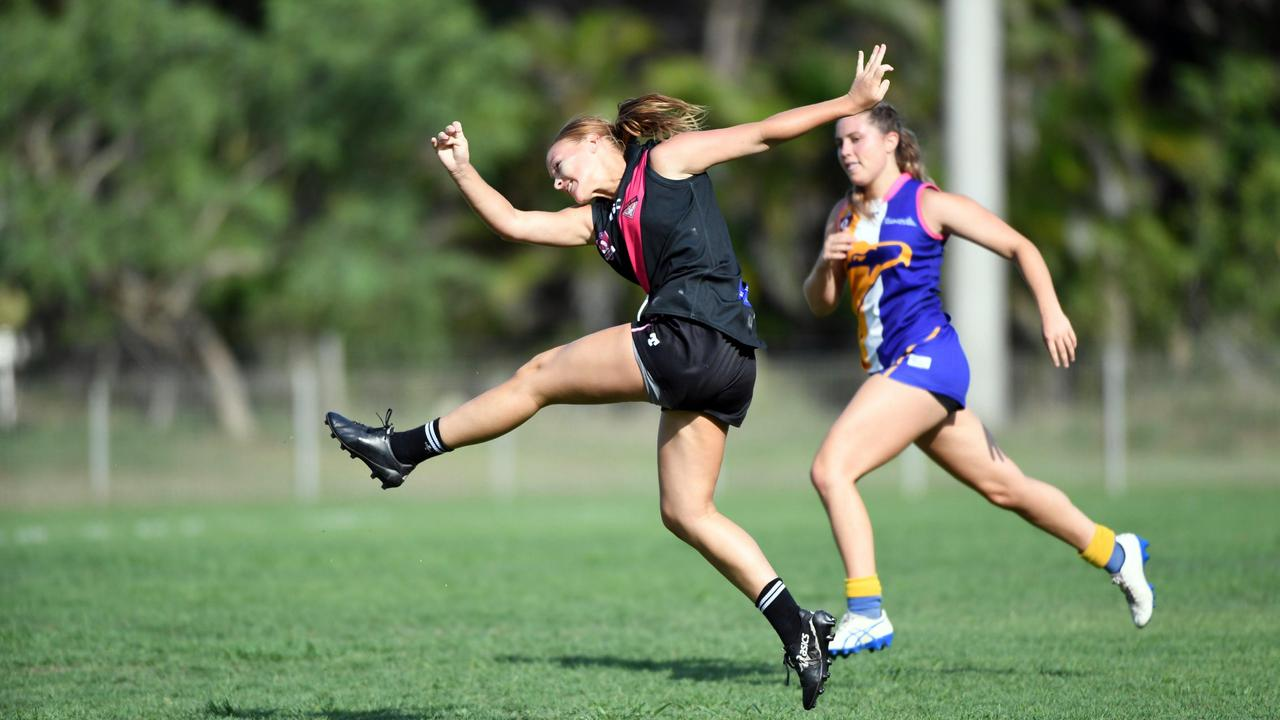 2020 AFLWB Takalvans Womens - Hervey Bay Bombers (Black) v Across the Waves (Blue) - Lauren Anderson puts everything behind her kick. Photo: Cody Fox