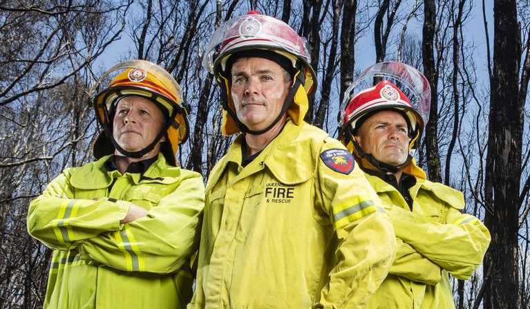 Noosa Heads Station Officer Rob Frey, Maroochydore Area Commander Cameron Herbert and Inspector Bernie Massingham back at the scene where an out of control bushfire was stopped, saving thousands of homes at Peregian Beach. Picture: Lachie Millard