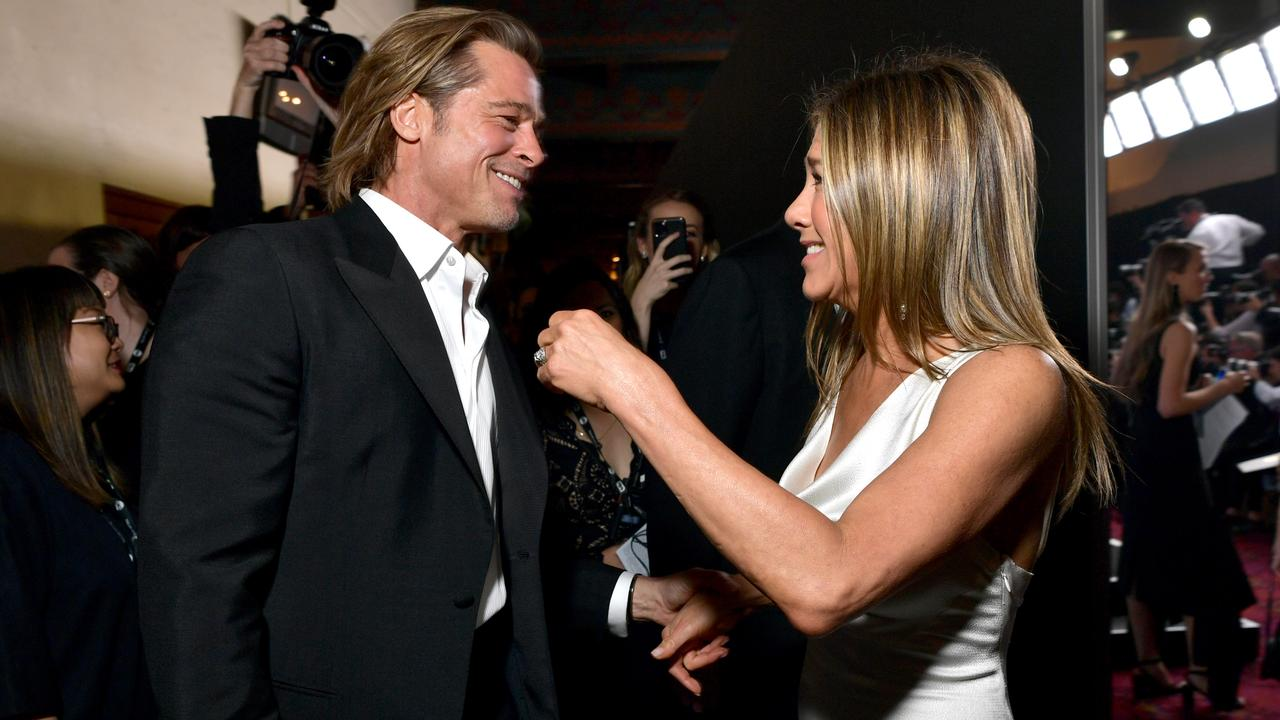 Friendly exes Brad Pitt and Jennifer Aniston backstage at the SAG Awards. Picture: Getty Images