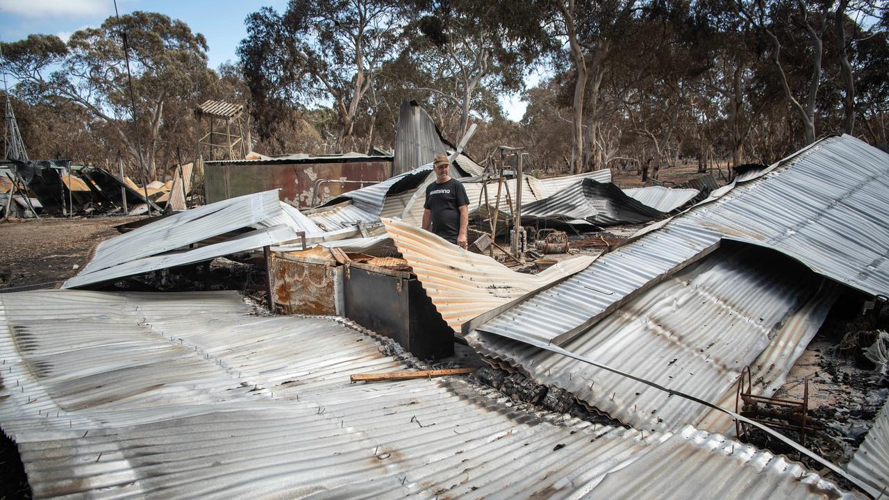 Shane surveys the wreckage of his home, lost in the fire. Picture: Brad Fleet