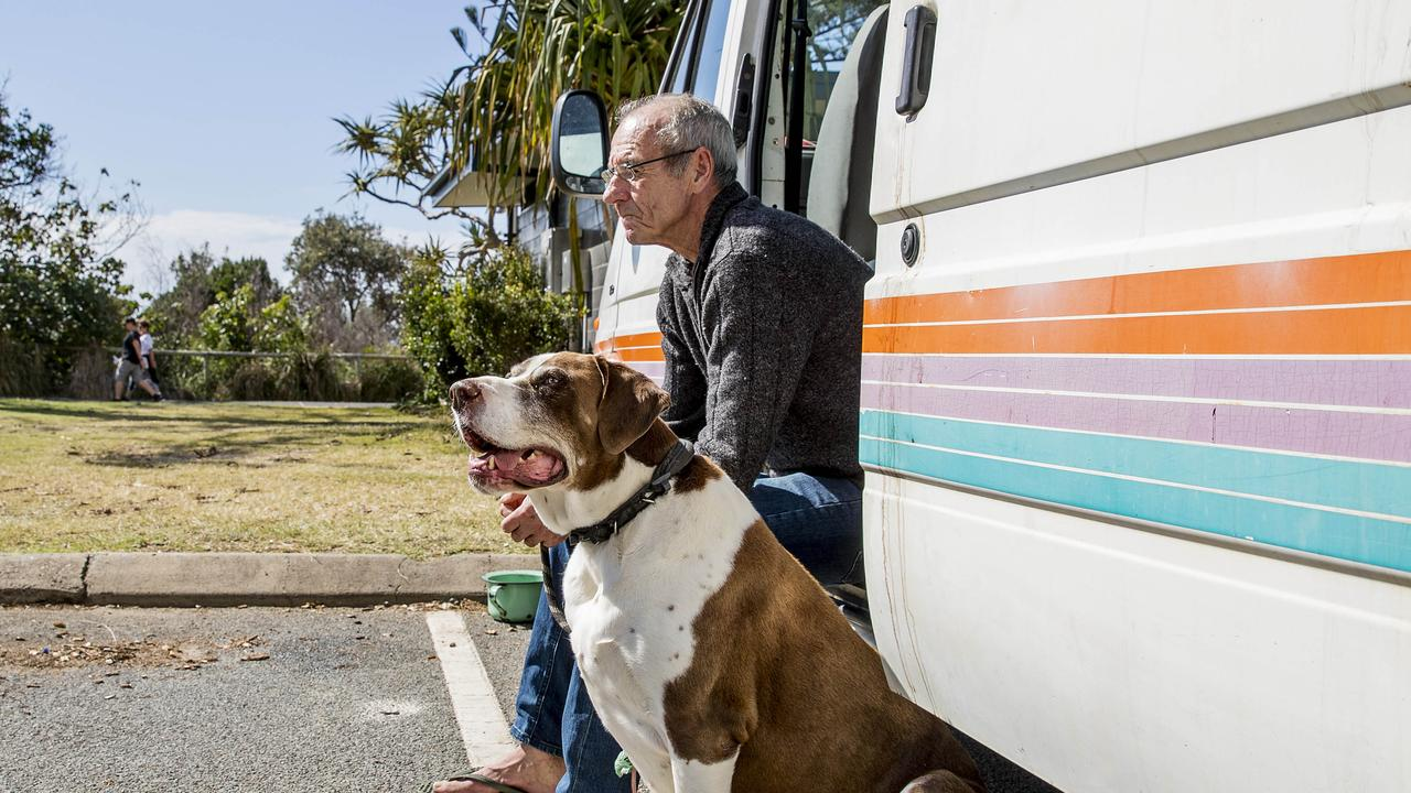 Graeme Aitken lives with his dog Duke in a van at Burleigh Beach. Picture: Jerad Williams