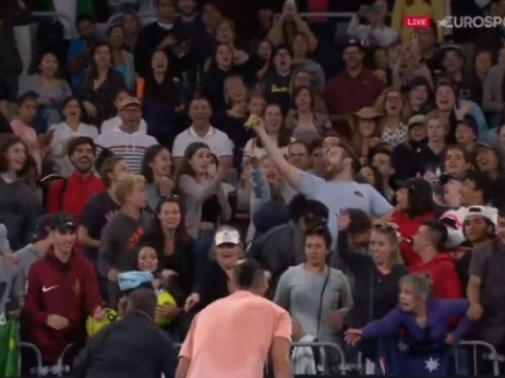 Nick Kyrgios tosses a banana into the crowd.