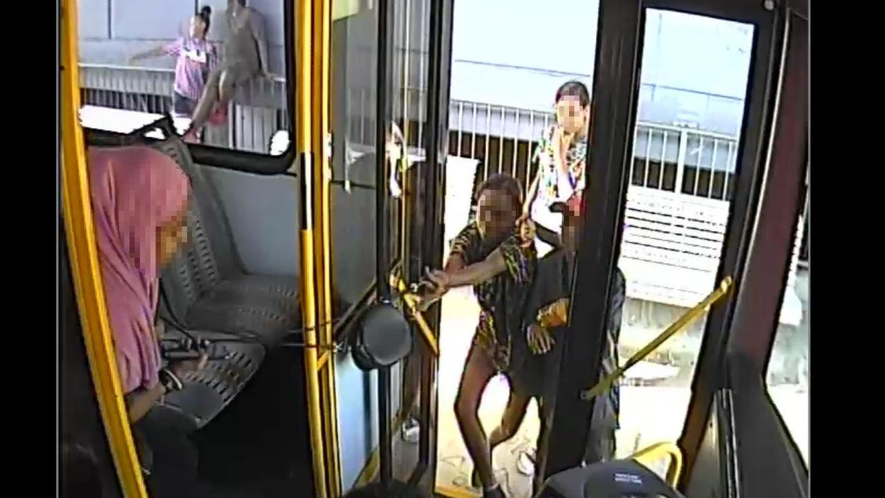 The teens can be seen trying to steal a young bus passenger's handbag.