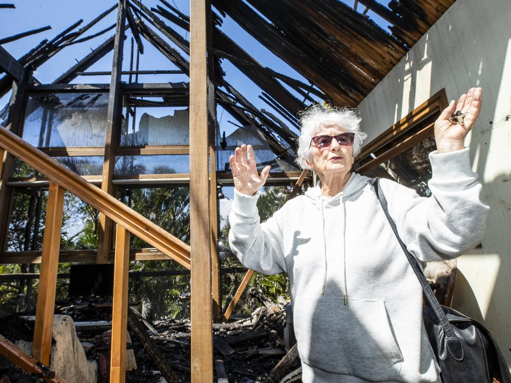 Peregian Beach resident Pam Murphy in the wreckage of her home on Plover Street which was destroyed by bushfire. Picture: Lachie Millard