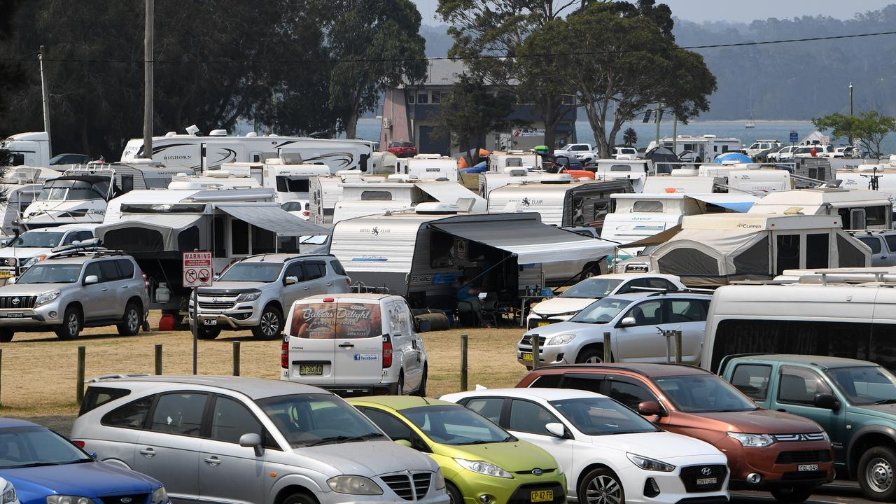 Cars parked outside the Hanging Rock Evacuation Centre. Picture: Dean Lewins/AAP