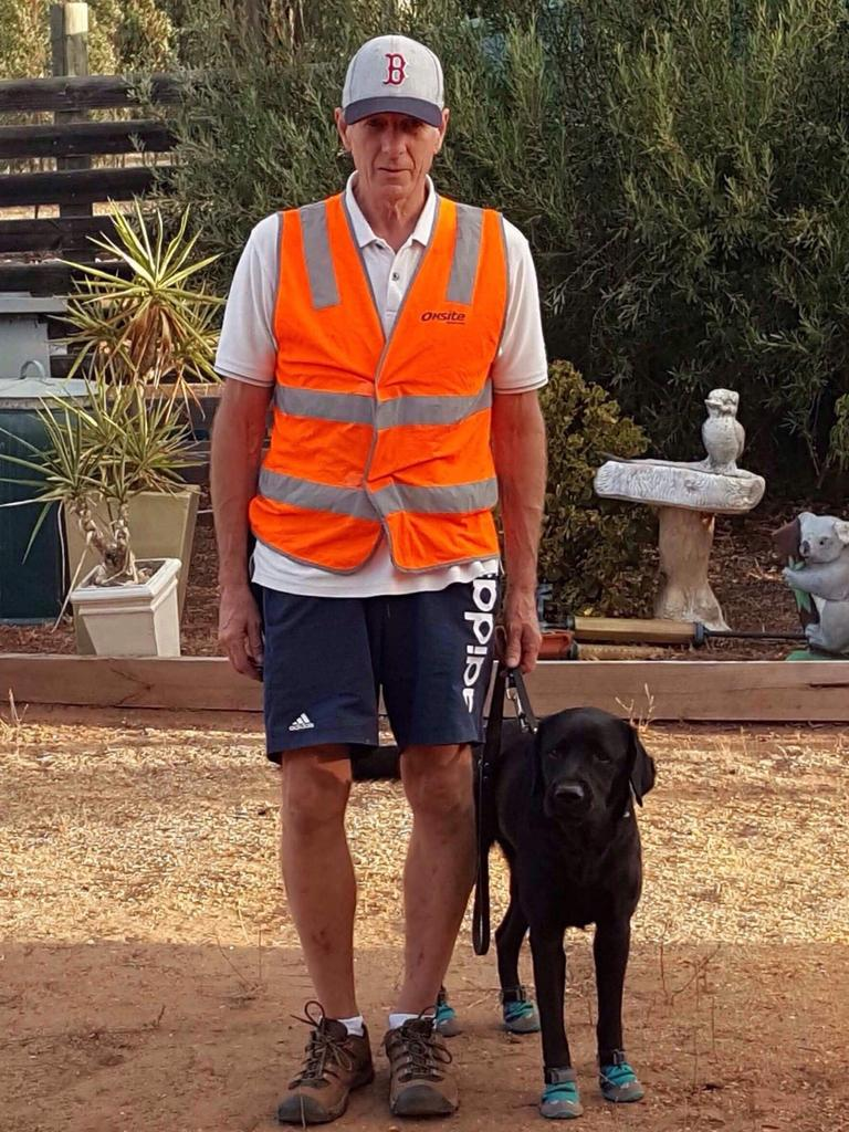 Raymond Meadows and his guide dog Gerry.