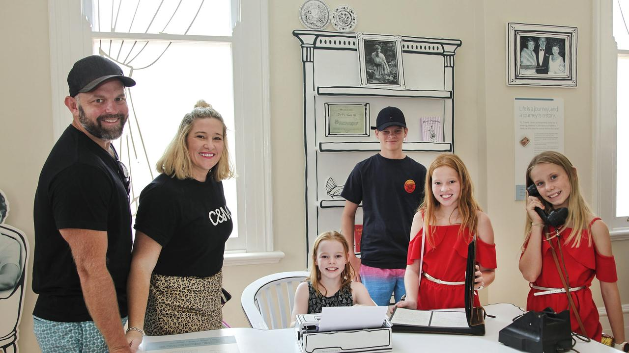 Nathan and Cassie Wilson, Imogen Wilson, Max Wilson, Anabel Wilson, and Ellie Stewart, all of Hervey Bay, explore Maryborough's Story Bank Museum.