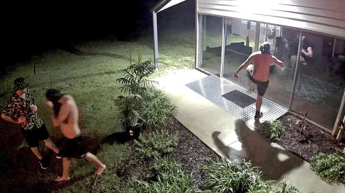 Vandals heard laughing while smashing glass doors