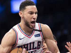World reacts to Simmons' historic outing
