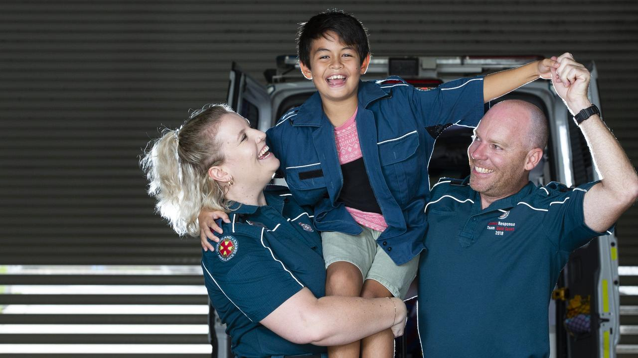Advanced Care paramedic Laura Perryer and Critical Care Paramedic Casey Robinson with Jaiden Grant. Photo: AAP/Renae Droop