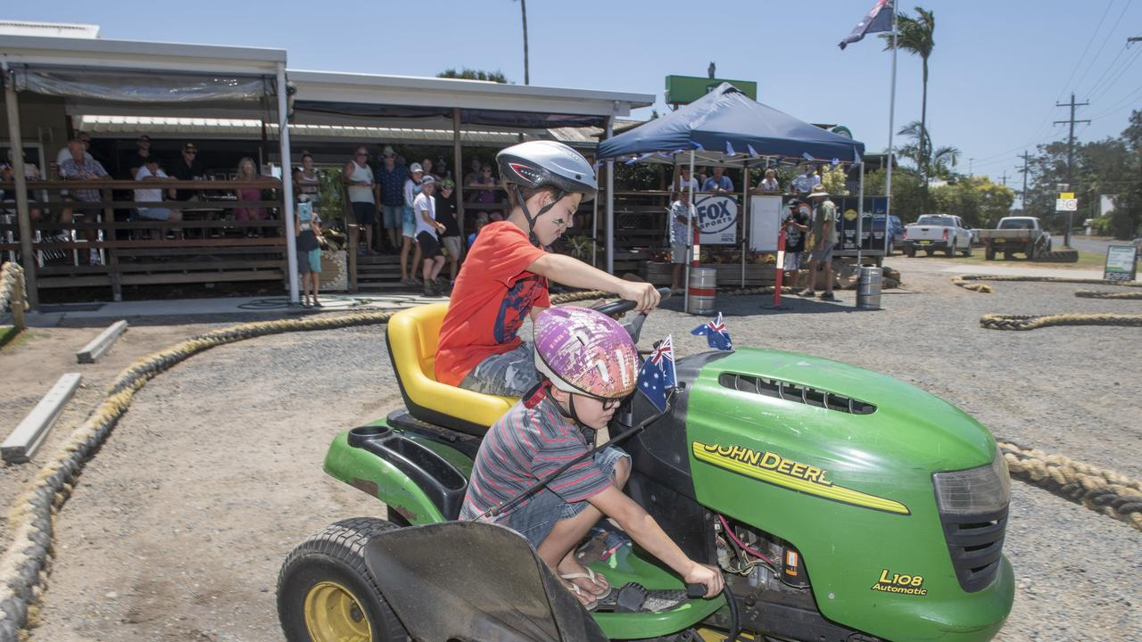 Jaali and Dante O'Sullivan of Harwood take a novel approach to driving a ride on in the Australia Day event at the Harwood Hotel.