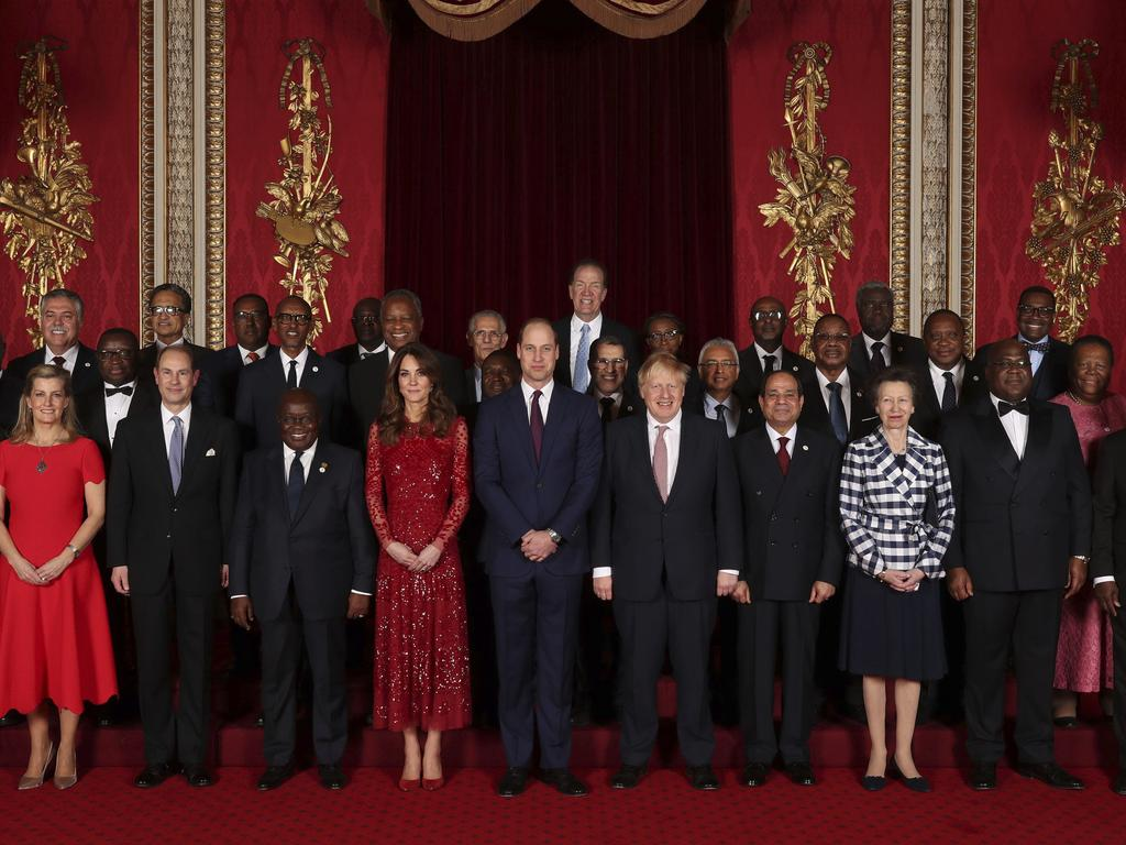Britain's Prince William, centre and Kate, the Duchess of Cambridge pose for a photo with Heads of Government, Ministers and members of NGOs as they host a reception at Buckingham Palace. Picture: AP