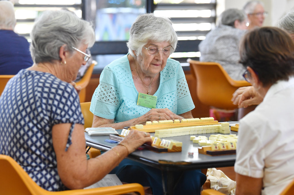 Image for sale: Bonnie Hull plots her next move in a game of Mahjong. Picture: Tony Martin