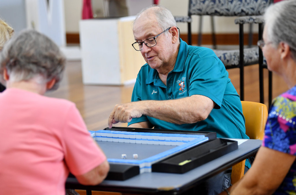 Image for sale: Joe Clutterbuck sets up for another game of Mahjong. Picture: Tony Martin