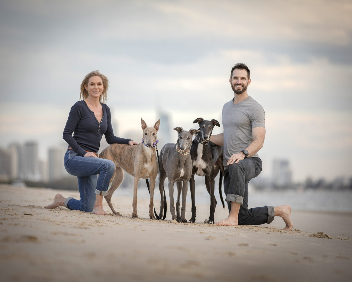 Jackie and her husband Brad with their rescued greyhounds Tia, Zoe and Teddy.