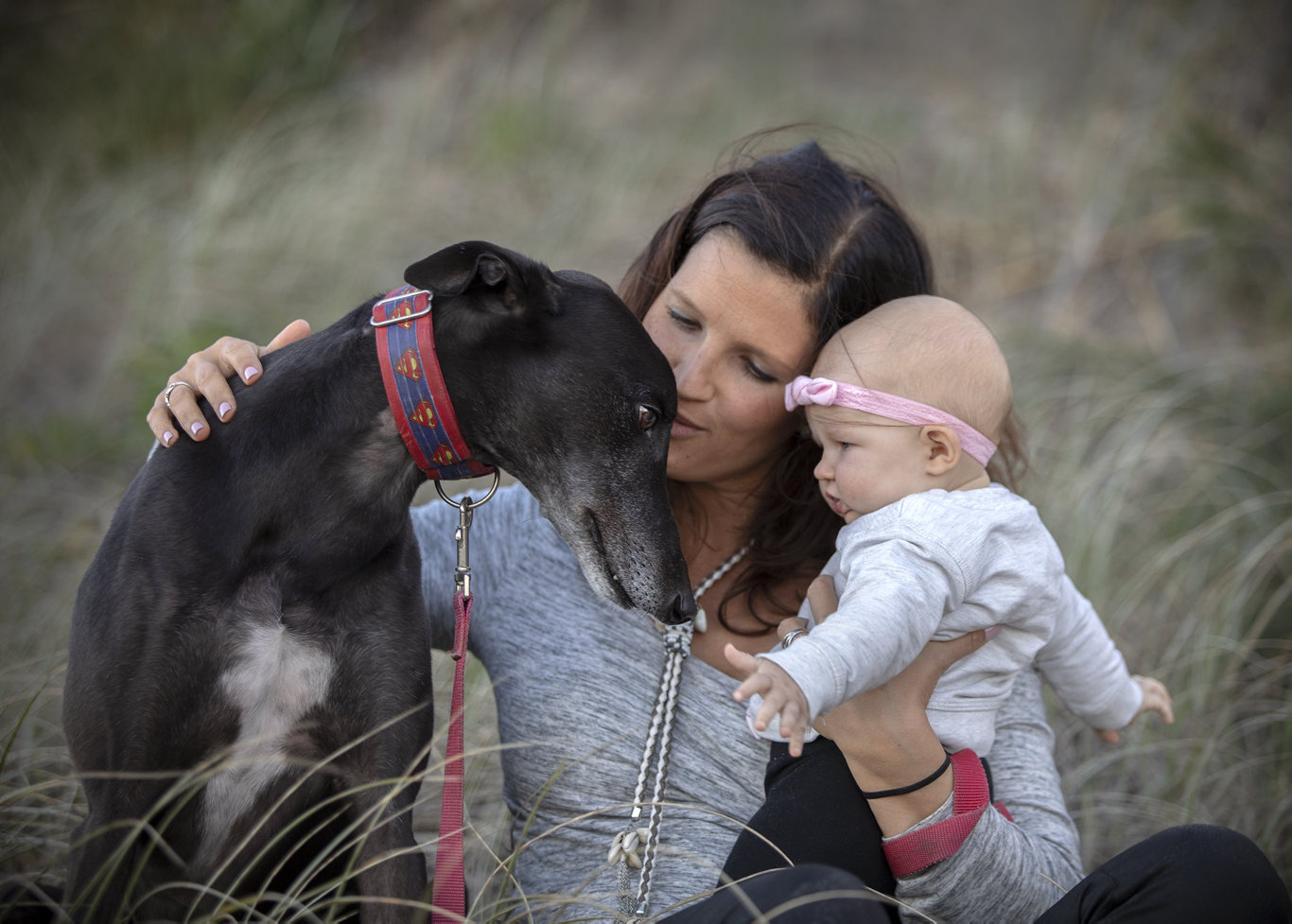 Aleisha Henslee with Otis the greyhound and their baby daughter.