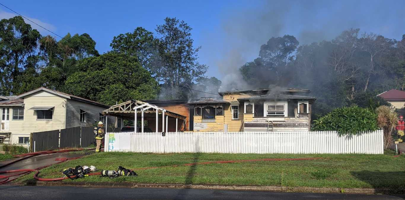 Firefighters work to bring a Nambour house fire under control.