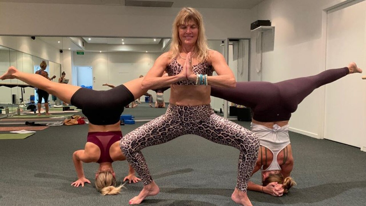 UPS AND DOWNS: Nancy Norby, Emma Plasier and Joti-May Beach limber up for the Yogathon at Aloha Active Yoga Studio.