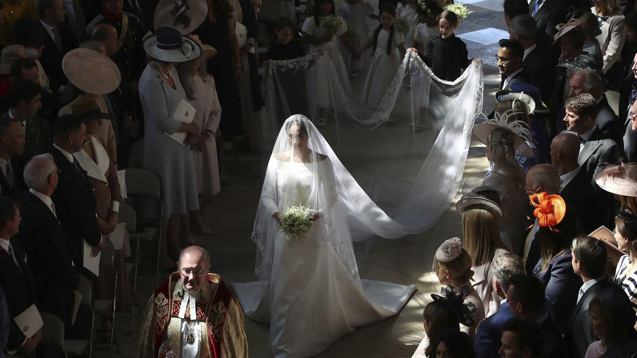 Meghan Markle walking down the aisle at her and Harry's wedding in May 2018. Picture: AP.