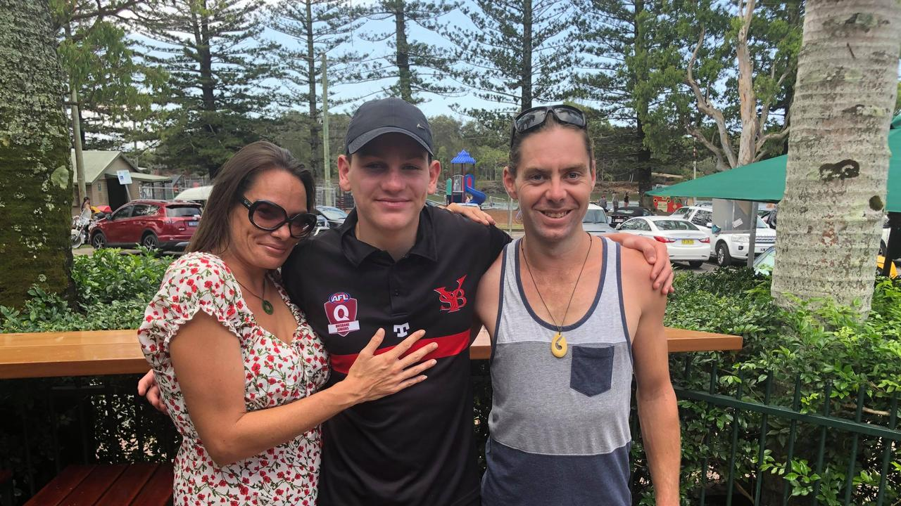 Hero Tweed Heads Coolangatta Surf Life Saving Club nipper Clayton Schilg reunited with (L) Ben Jeffrey and (R) Mr Jeffrey's partner Christine Campbell on Sunday at Brunswick Heads. Mr Jeffrey one of the men he saved from drowning in a rip at Wooyung Beach on January 9.