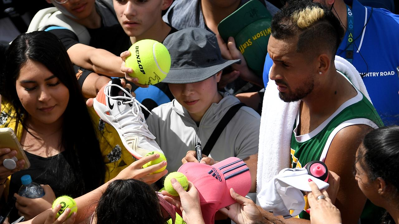 Once shunned by the Australian sporting public Nick Kyrgios - swamped by fans after an Australian Open training session - is now their favourite son. Picture: Lukas Coch/AAP