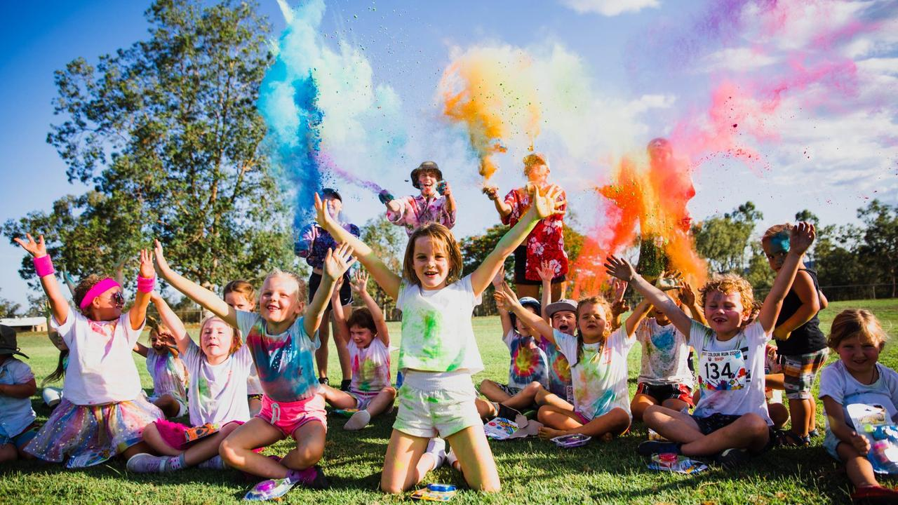 BRIGHT: Maizee Kiro and McKenzie Oliver (middle) joined more than 200 community members who turned up for the 2020 Colour Run hosted by the Dysart Senior Rugby League Football Club on January 18.