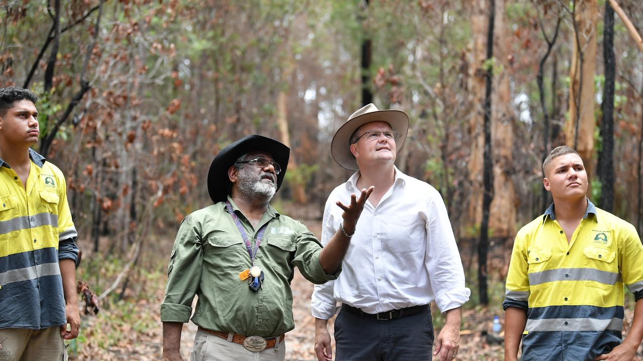 Tais Muckan, an Umdumbi family elder of Kabi Kabi nation, with his sons Lawrence Muckan and Lee-Samuel and, of Noosa Landcare. The trio show Fairfax MP Ted O'Brien how traditional land management practices could be used in bushfire preparations. Photo Patrick Woods / Sunshine Coast Daily.
