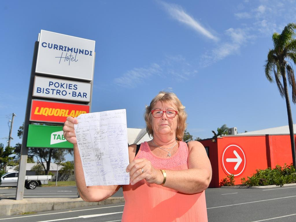 Pam Schultz with a petition that's gathered more than 100 signatures pleading for the Currimundi Hotel to reinstall its TAB window. Picture: John McCutcheon