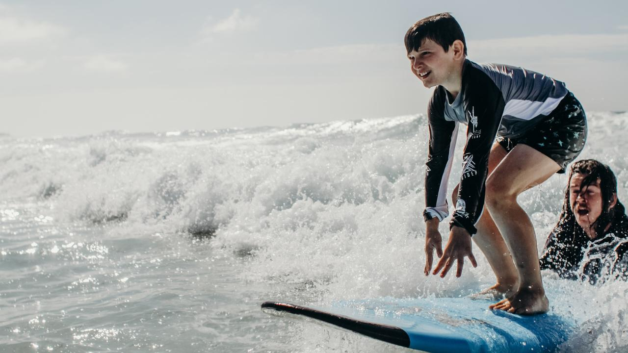 On Sunday it's expected 60 families of children with autism will attend the Surfing the Spectrum event at Lennox Head Beach near the surf club.