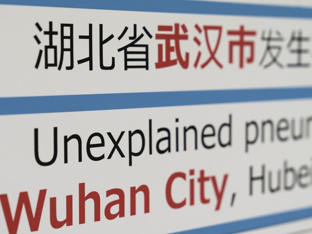 A notice for passengers from Wuhan, China is displayed near a quarantine station at Narita airport. Picture: Getty