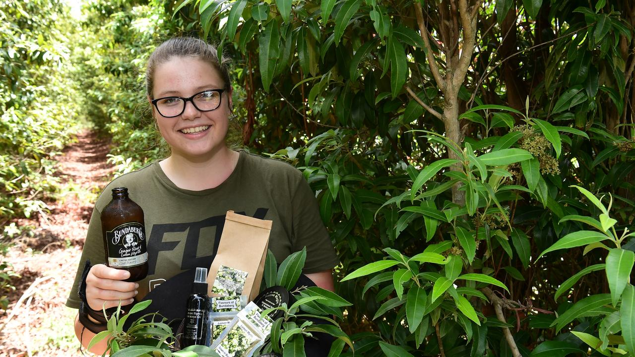 April Logan with a hatful of products that contain lemon myrtle from the family's Gooburrum farm.