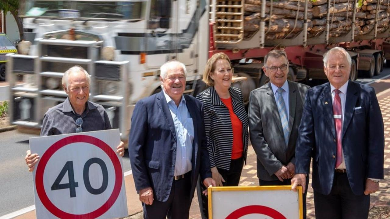 GO SLOW: Local MP Mick Murray, second from left, is joined by Road Safety Minister Michelle Roberts and other supporters for the announcement.