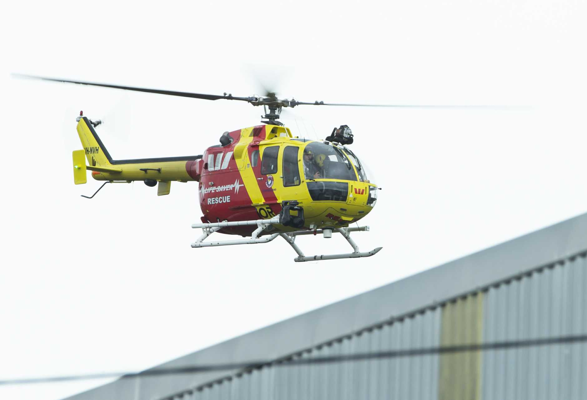 A rescue helicopter returns to base at Caloundra Aerodrome where a charter plane departed on Wednesday afternoon.