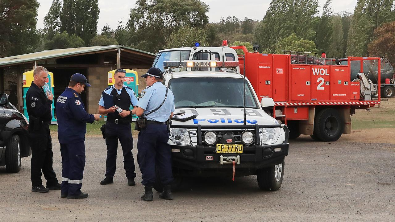 Police and Rural firefighters at Numeralla near the scene of a crashed water tanker plane. Picture: Mark Evans/AAP
