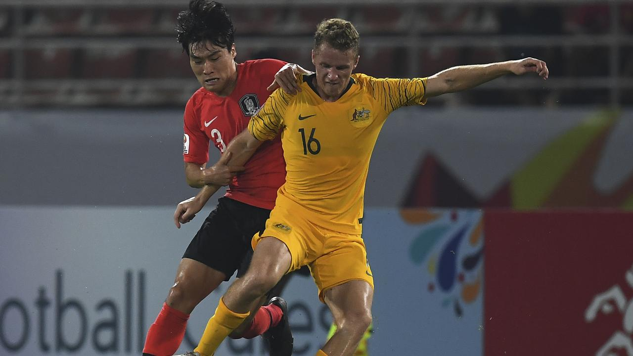 Kang Yoon-seong of South Korea, left, fights for the ball with Trent Buhagiar of Australia during the AFC U-23 Championship 2020 semi-final round at the Thammasat University stadium in Pathumthani province, Thailand, Wednesday, Jan. 22, 2020. (AP Photo/Thanachote Thanawikran)