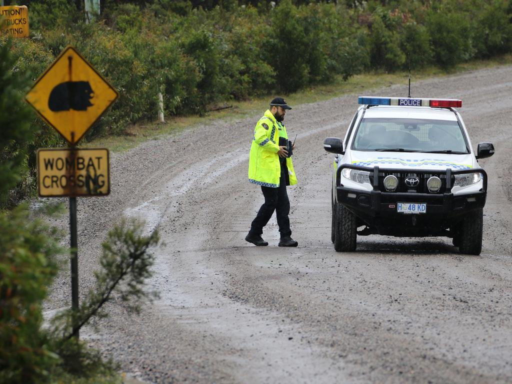 Tasmania Police at a road block at Henty Gold Mine in Tasmania's west where a man is believed to be missing following a rock fall. Picture: GRANT WELLS