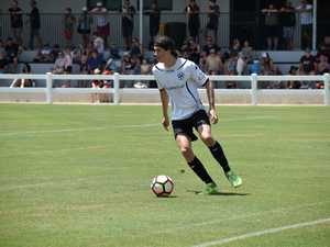 Magpies left back Stefan Mawer looks for his passing