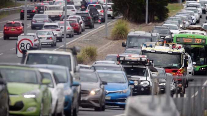 Gravel truck rolls on Pacific Motorway at Tugun