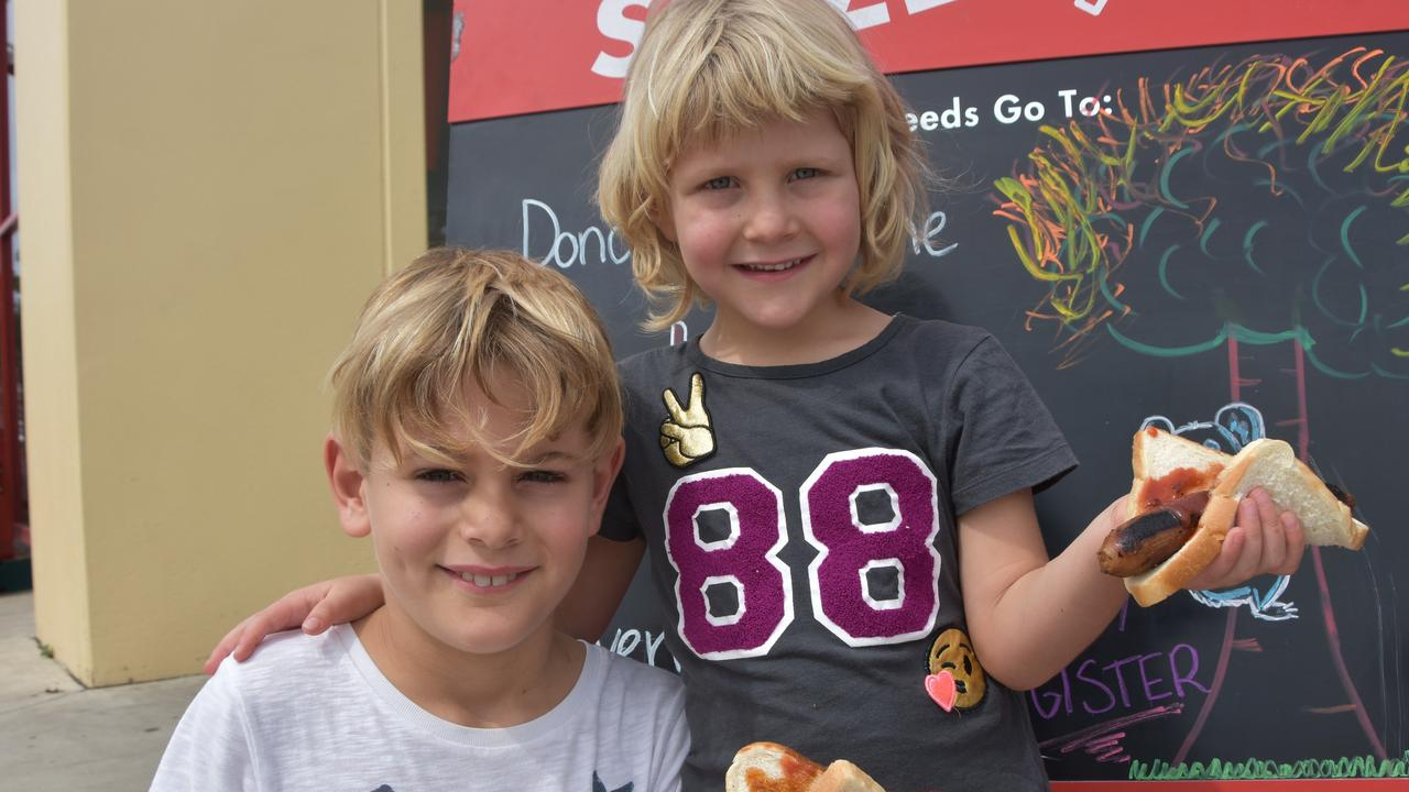 TASTY: Oliver and Elisabeth Weston enjoyed a sausage sizzle at Bunnings Noosaville to help raise money for the Red Cross bushfire appeal. Photo: Caitlin Zerafa