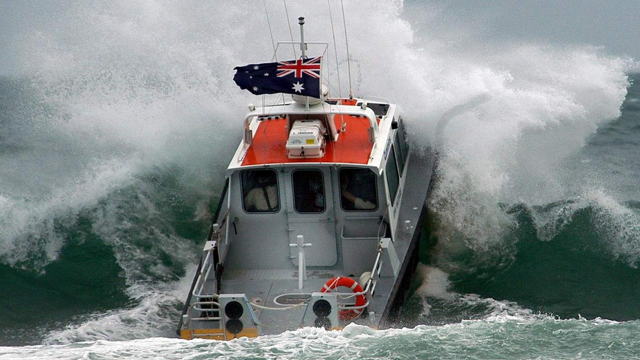 Coast Guard Noosa boat John Waddams' on the Noosa Bar as huge seas are whipped up by a tropical low off the Queensland Coast.
