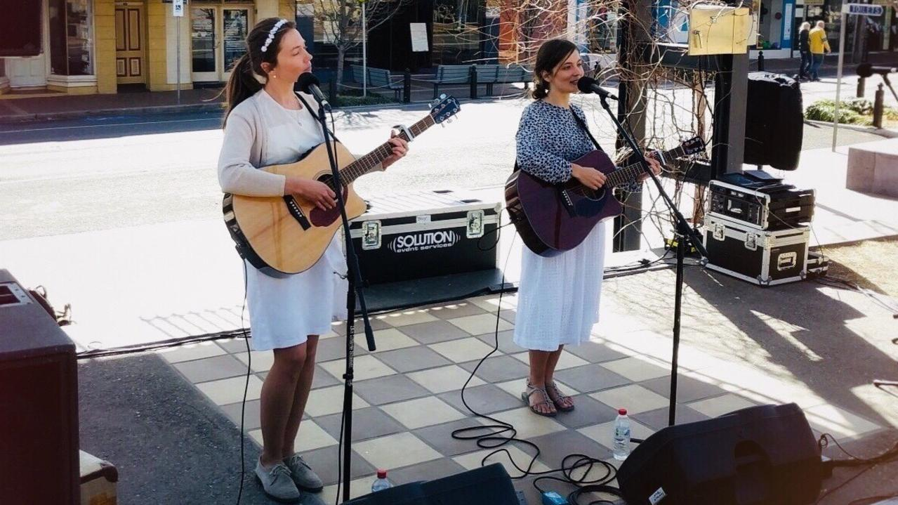 Nine Year Sister performing on Maryland St in September last year.