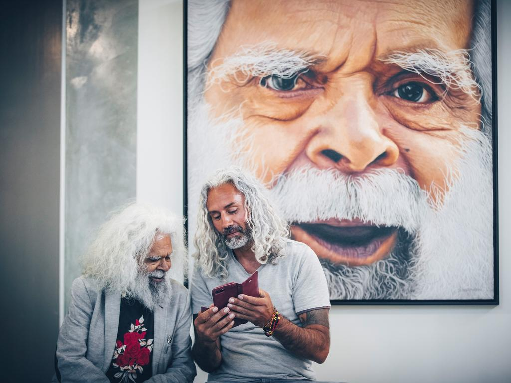 Uncle Jack Charles with blood relation Jandamarra Cadd's painting entitled Cleverman that won the 2019 Sunshine Coast Art Prize People's Choice award. Image: ben vos productions.