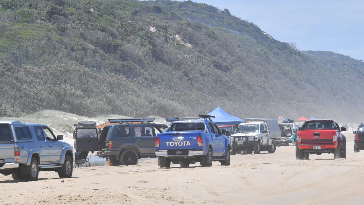 Police officers on the beach at Teewah conduct alcohol, drug and speed testing of drivers. Traffic on the beach at Teewah. Photo: John McCutcheon / Sunshine Coast Daily