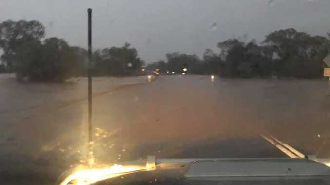 Flash flooding slows Warrego Highway traffic