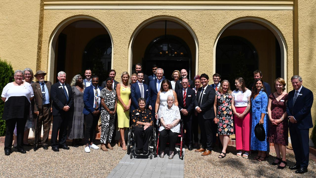 Prime Minister Scott Morrison and wife Jenny pose for photographs with the finalists. Picture: Mick Tsikas/AAP