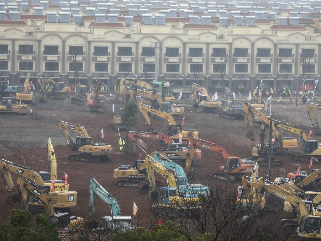Workers are scrambling to build a 1000-bed field hospital in Wuhan, China, by February 3 to cope with the surge coronavirus patients in the city. Picture: Getty