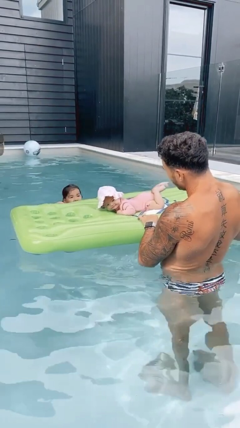 Darius Boyd at home with baby daughter Romi, whose name he has tattooed on his shoulder, and four-year-old Willow on Friday. Photo: Instagram / @kaylaboyd_