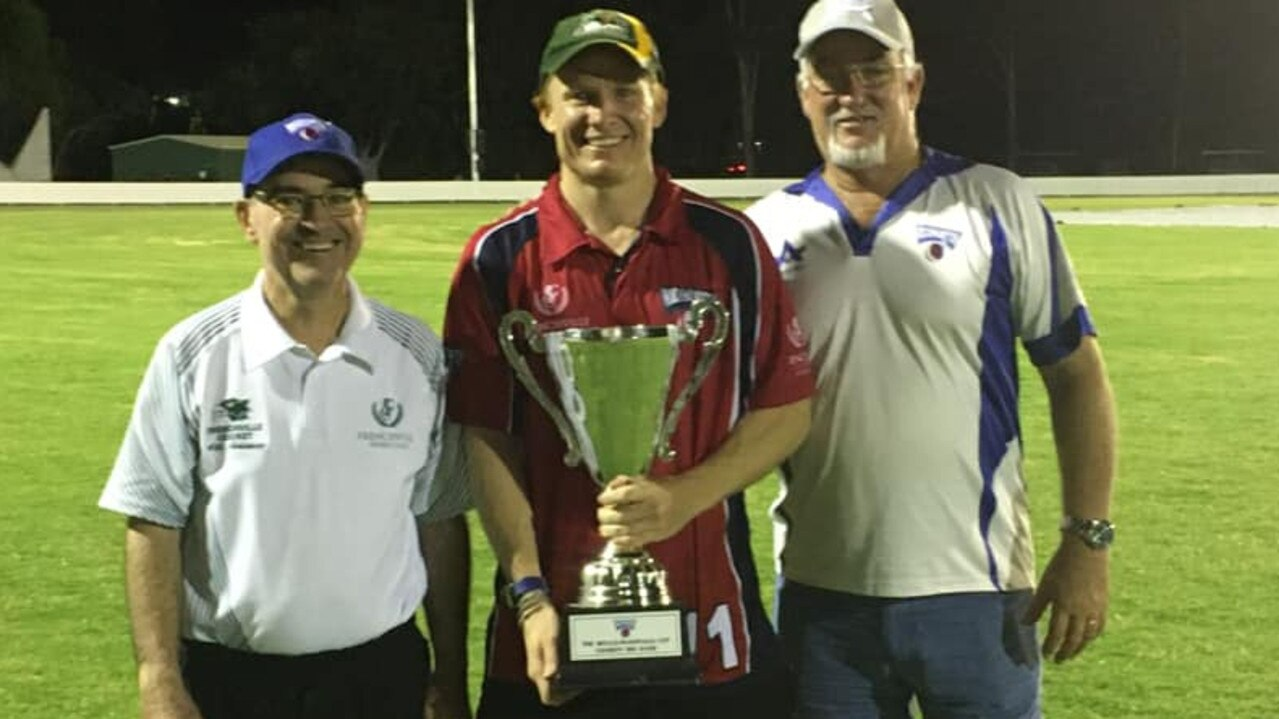 WELL PLAYED: Victorious Northside skipper Todd Harmsworth (centre) is presented with the Wells-McDonald Cup by Peter Wells and Dale McDonald.